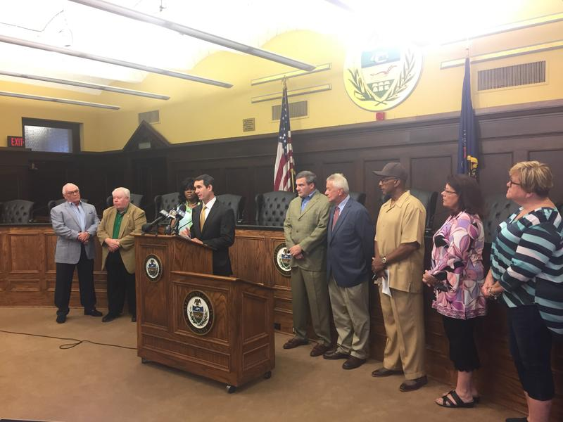 Eugene DePasquale, flanked by municipal officials who represent the Woodland Hills School District, speaks in Pittsburgh on Wednesday, July 18, 2018.