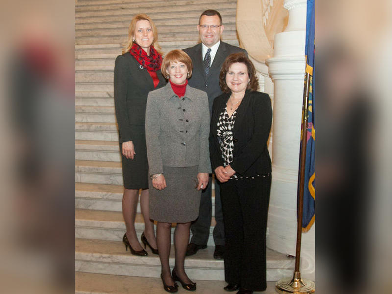 Lori Mizgorski (upper left) with state Rep. Hal English and other members of his staff.