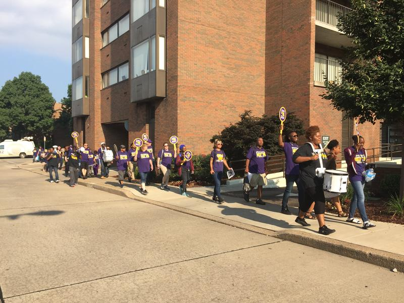 Protestors march in the North Side across from Nova Place on Friday, July 13, 2018.