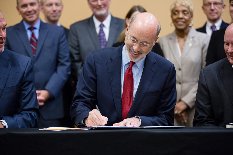 Gov. Tom Wolf signs an executive order that implements a $30 million workforce development initiative on Tuesday, July 10, 2018, in Harrisburg.