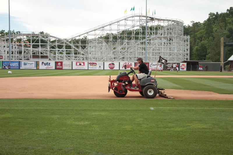 "Head groundskeeper McClain Murphy drags the infield in this July 2016 photo. ""And then as far as the grass goes...it's a living breathing thing. You have to take care of it just like it's a human."""