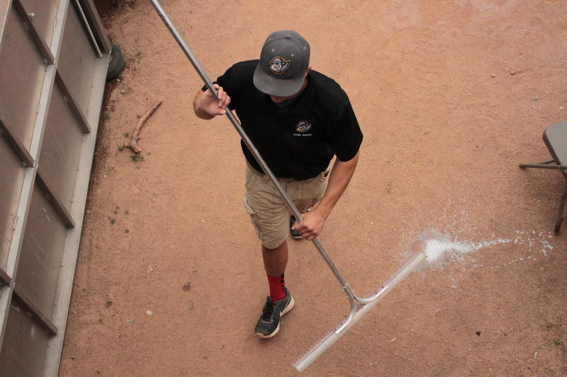 One of the Altoona Curve's grounds crew returns from raking the infield before the game.