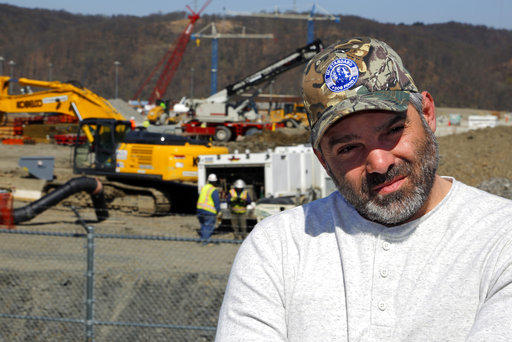 In this April 30, 2018 photo, Chip Kohser, the Beaver County Republican Chairman, stands overlooking the construction of a chemical plant on the banks of the Ohio River near Beaver, Pa.