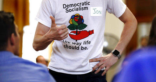 Jon Torsch wears a T-shirt promoting democratic socialism at an event in Portland, Maine on July 16, 2018.
