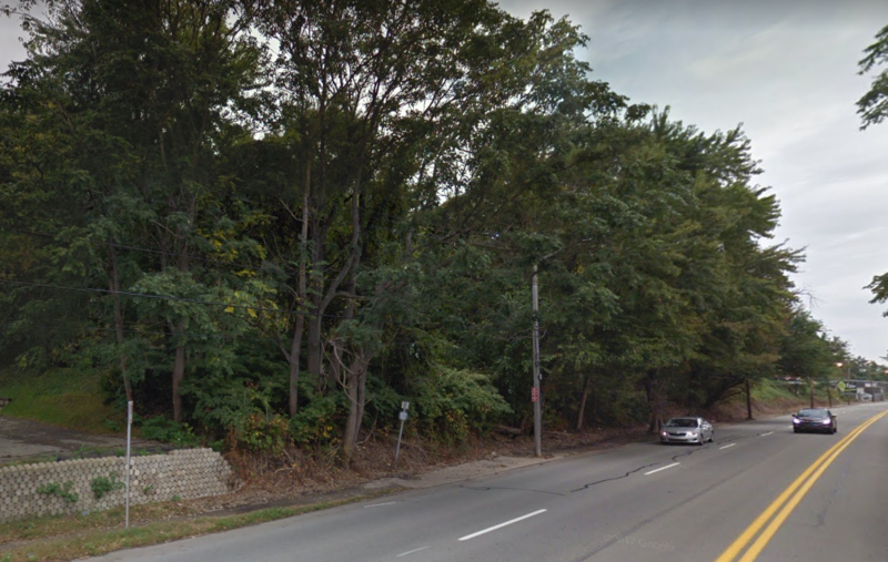 Irvine Street in Hazelwood lacks a consistent sidewalk, which makes walking along it difficult.