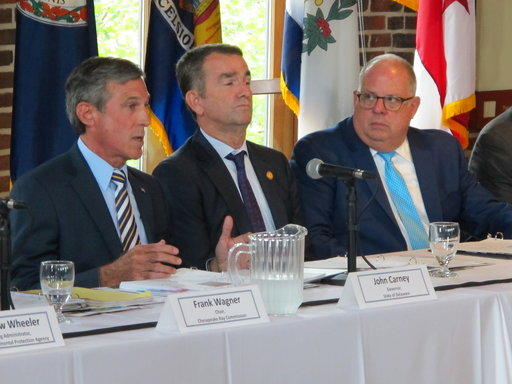 Delaware Gov. John Carney, left, speaks at a meeting of the Chesapeake Executive Council on Tuesday, Aug. 7, 2018.