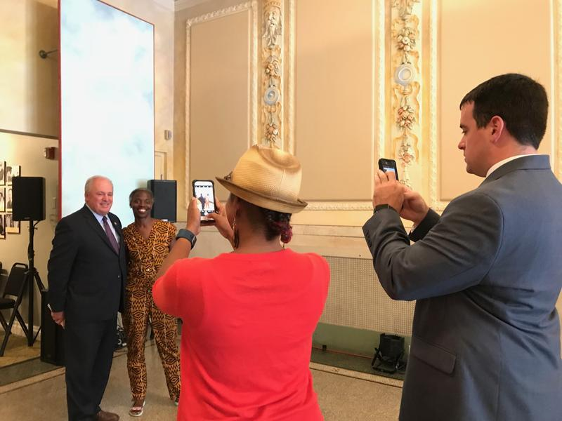 Pennsylvania Congressman Mike Doyle poses for a photograph with Janera Solomon, executive director of the Kelly Strayhorn Theater. Social media, one of the many tools enabled by the Internet, has helped to build the theater's audience, says Solomon.