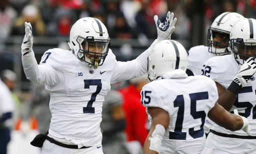 Penn State linebacker Koa Farmer celebrates recovering a fumble in a game against Ohio State.