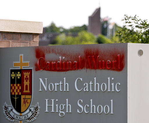 Paint covers the name of Cardinal Donald Wuerl at North Catholic High School on Monday, Aug. 20, 2018 in Cranberry Township, Pa.