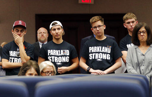 Student survivors from Marjory Stoneman Douglas High School enter a house legislative committee hearing, to interrupt and challenge lawmakers on gun control reform, in Tallahassee, Fla., Wednesday, Feb. 21, 2018.