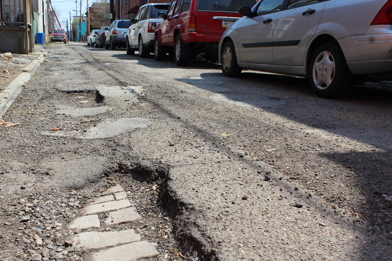 A pothole in the Hill District on Friday, April 13, 2018.