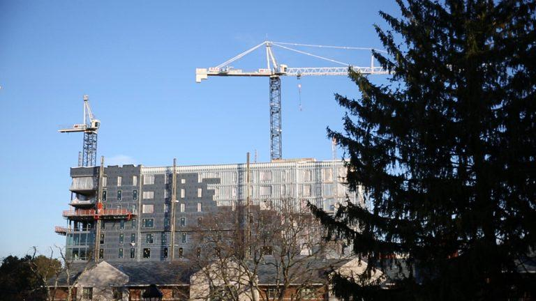 Construction can be seen on one of the high-rise buildings going up in State College.