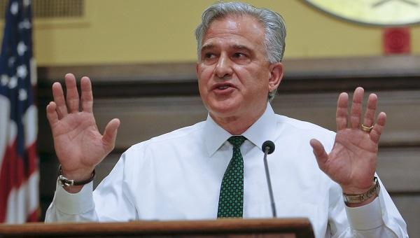 Allegheny County District Attorney Stephen Zappala Jr. raises his hands describing actions of Antwon Rose Jr., during a news conference on Wednesday, June 27, 2018, in Pittsburgh.