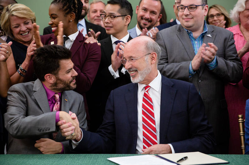 Gov. Tom Wolf signs an executive order creating a state commission on LGBTQ affairs on Monday, Aug. 6, 2018.