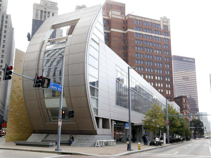 People walk past the August Wilson Center for African American Culture on Wednesday, Oct. 2, 2013, in Pittsburgh.