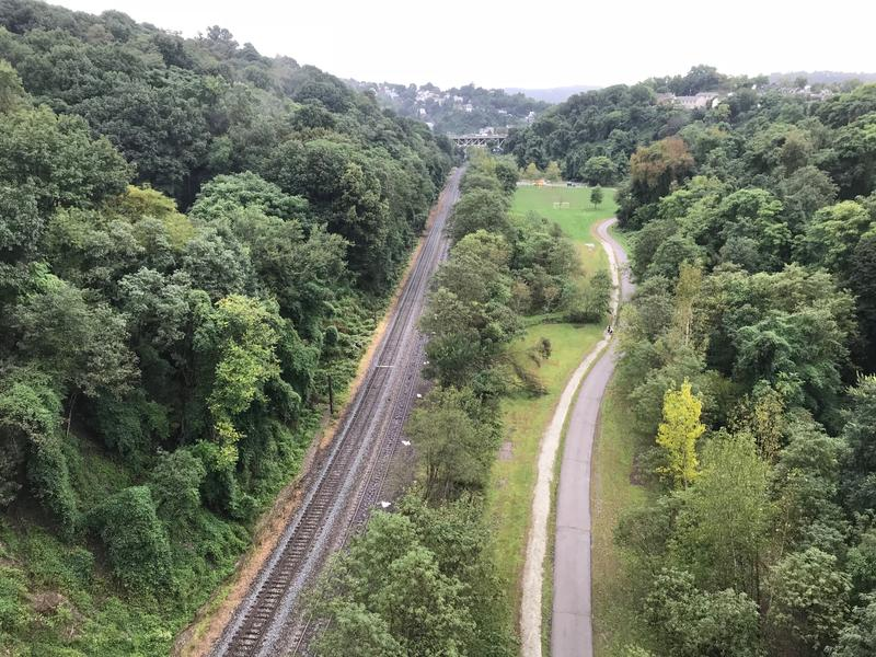 A rail line and a path run through Schenley Park, as seen from the Boulevard of the Allies in Oakland. The green infrastructure project planned for Four Mile Run will direct stormwater to the Monongahela River either underground through a tunnel or above