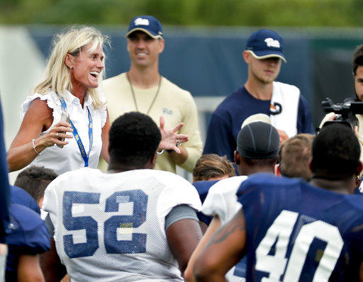 University of Pittsburgh athletic director Heather Lyke, left, talks to the Panther football team during a team practice, Thursday, Aug. 9, 2018, in Pittsburgh.