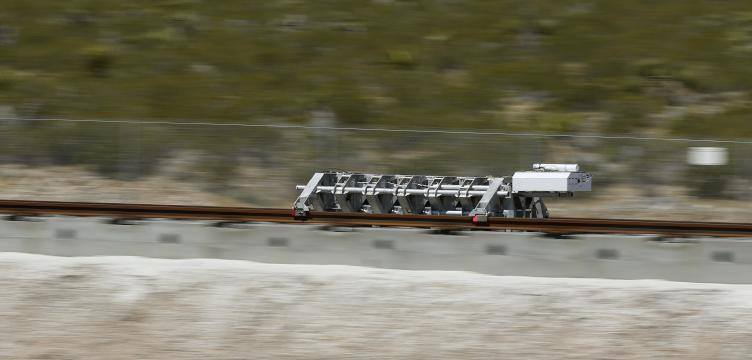 A sled speeds down a track during a test of Hyperloop One propulsion system, Wednesday, May 11, 2016, in North Las Vegas, Nev.