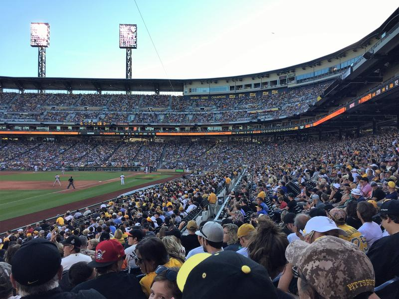 Crowds gather to watch a Pittsburgh Pirates baseball game at PNC Park on the North Shore.