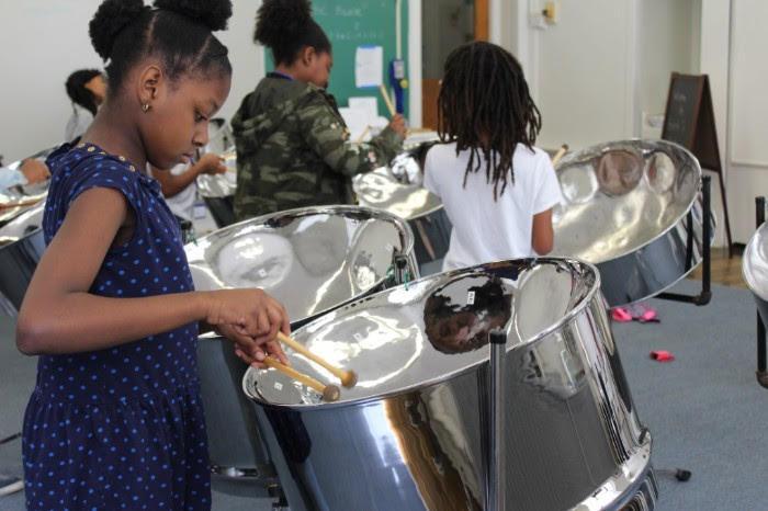 Kids with their steelpan drums at Pan Camp.