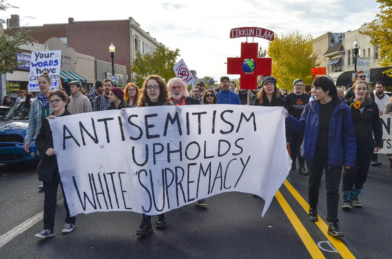Protesters march through Squirrel Hill on Tuesday amid President Trump's visit to the Tree of Life Synagogue following Saturday's shooting.
