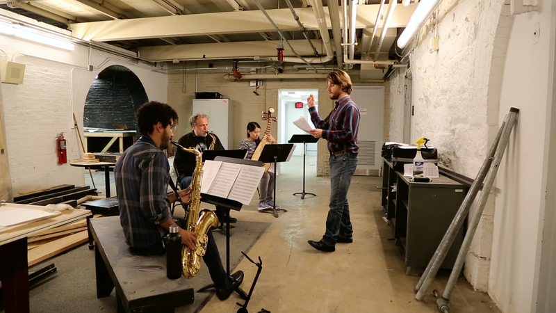 "Ben Barson, at right, leads a rehearsal for ""Mirror Butterfly."""