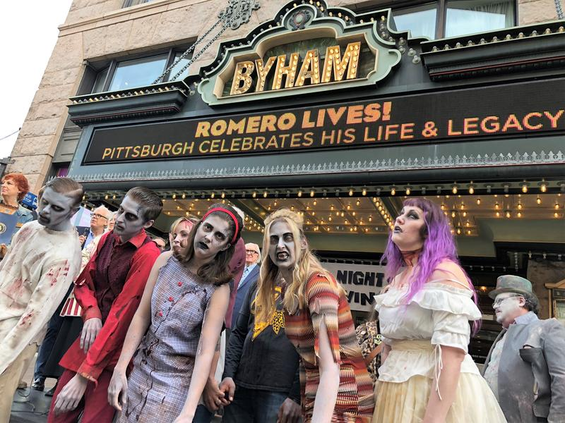"Zombies from the local haunted attraction, ScareHouse, stand in front of the Byham Theater, where an annivesary screening of ""Night of the Living Dead"" will take place this weekend."