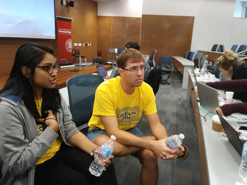 CMU graduate students Aysha Machingera and Patrick Campbell brainstorm ideas for the 2018 Code4PA hackathon.
