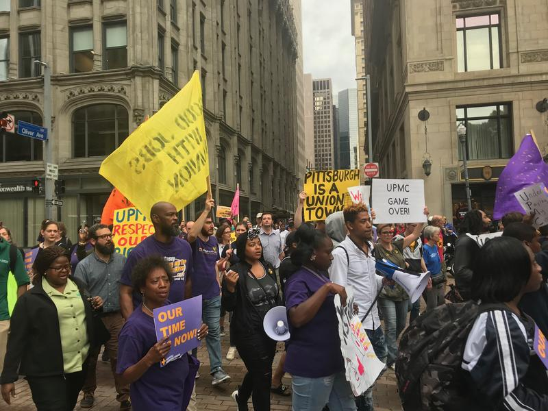 Protestors march along Grant Street in downtown Pittsburgh on Thursday, Oct. 4, 2018.