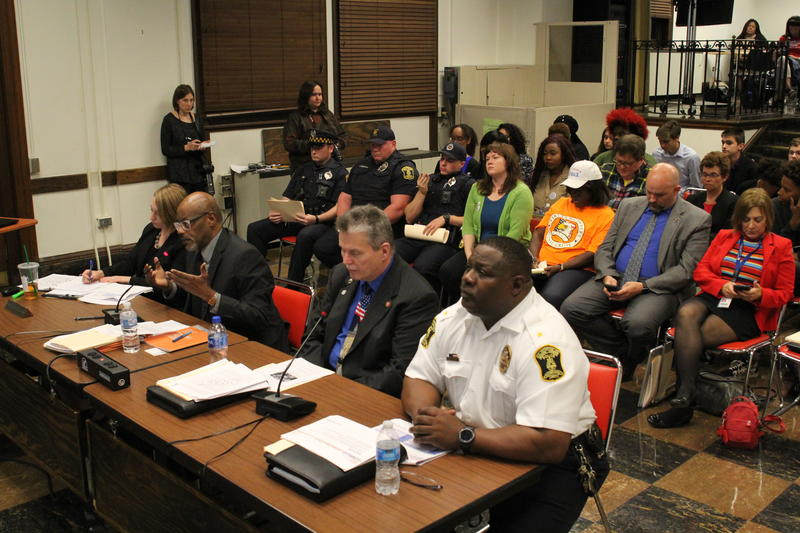 Harold Jordan, second from left, with the ACLU Pennsylvania appeals to the board Monday night to not allow officers to carry guns in schools.