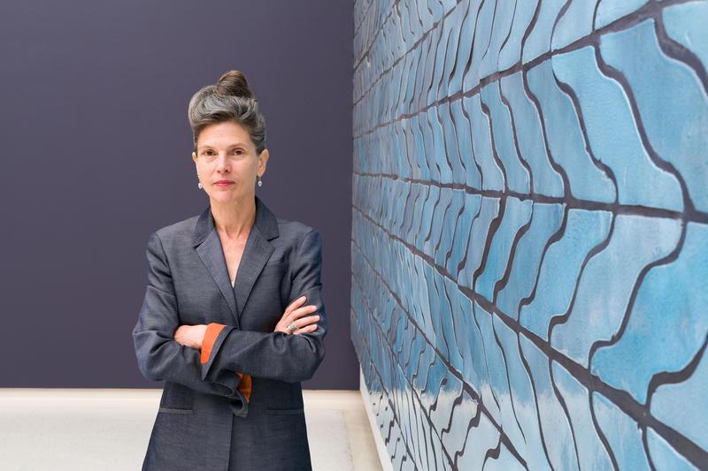 Carnegie International curator Ingrid Schaffner stands in front of Sarah Crowner's Wall (Wavy Arrow Terracotta), 2018.