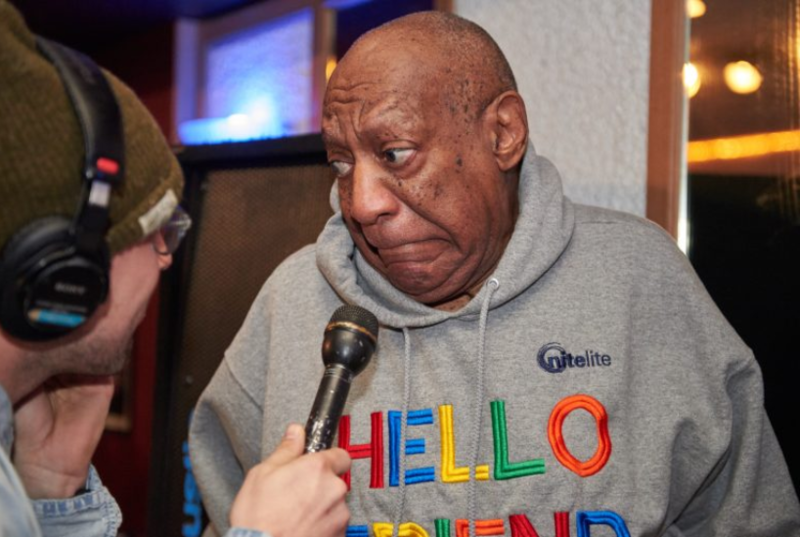 Bill Cosby makes a face after being asked a question by WHYY's Bobby Allyn about his retrial in April.