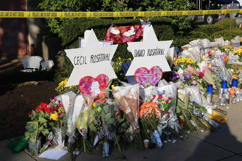 A makeshift memorial in front of Tree of Life honors the victims of a mass shooting.