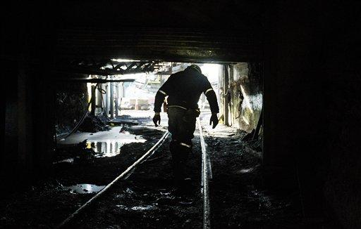"In this Oct. 6, 2015 photo, a miner walks out of the Sewel ""R"" coal mine in Yukon, W.Va."