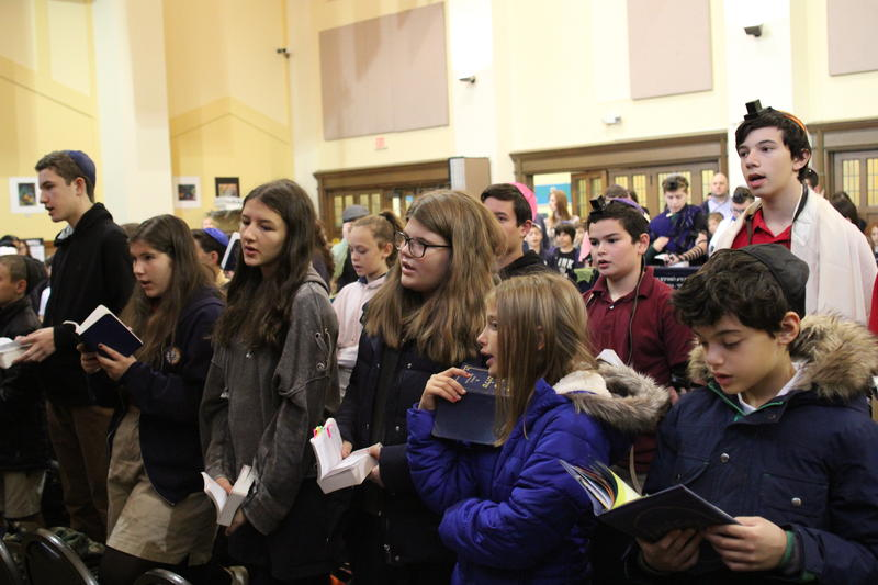 Students at the Community Day School hold a morning prayer service ahead of a remembrance service honoring those lost and affected by the deadly mass shooting at Tree of Life Congregation synagogue in Squirrel Hill on Saturday, Oct. 27, 2018.