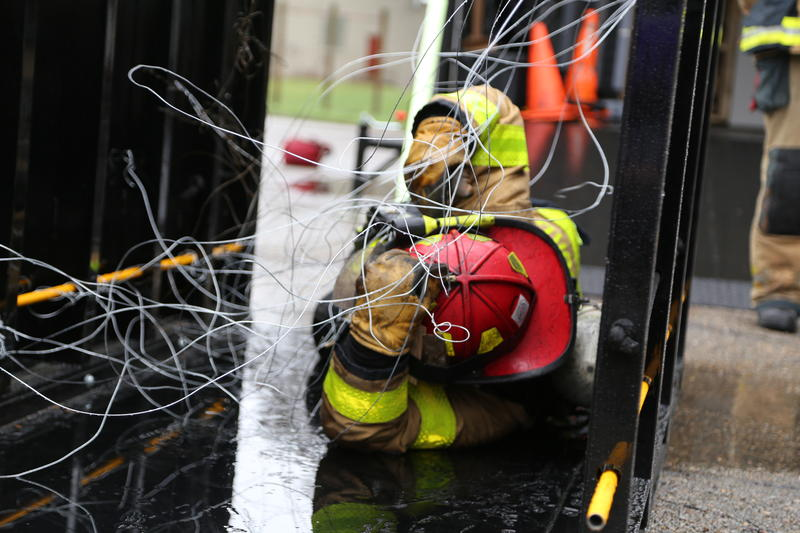 A firefighter participates in a training drill at the training facilities on Washington Boulevard.