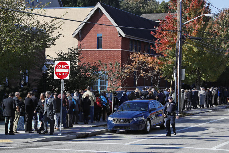 Mourners line up around the block from the Jewish Community Center in the Squirrel Hill section of Pittsburgh Tuesday, Oct. 30, 2018.