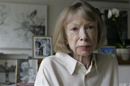 Author Joan Didion sits in front of of a photo of herself in her New York apartment in 2005.