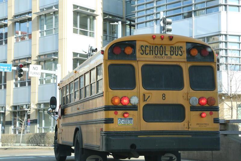 A school bus drives through downtown Pittsburgh.