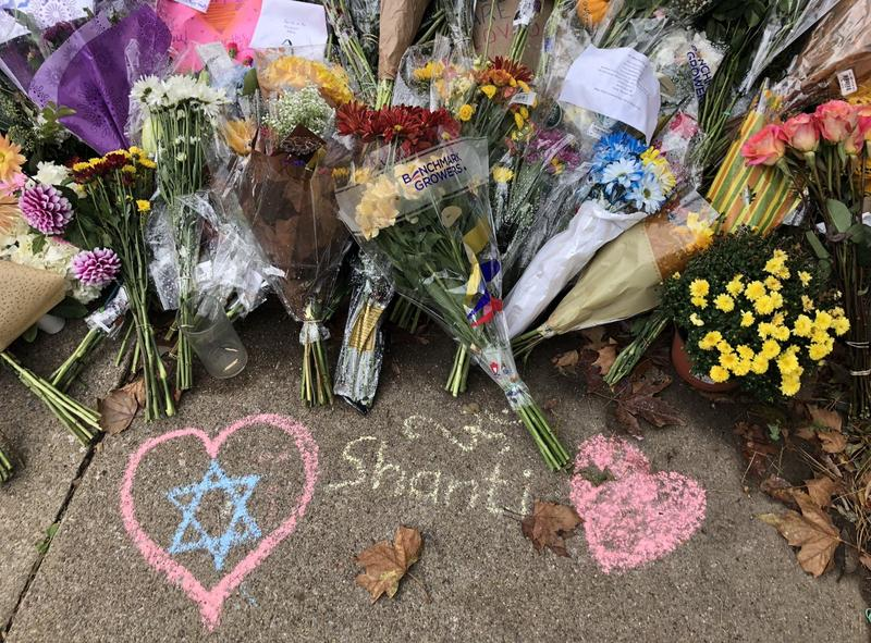 Candles, mementos, flowers and drawings litter the sidewalk and lawn outside Tree of Life Congregation synagogue in Squirrel Hill where a shooter killed 11 people and injured six others on Saturday, Oct. 27, 2018.