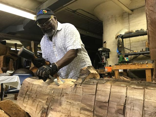 Thaddeus Mosley sculpts wood in his North Side studio.