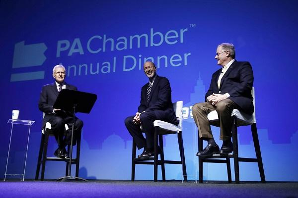 Alex Trebek, left, moderates a gubernatorial debate between Democratic Gov. Tom Wolf, center, and Republican Scott Wagner in Hersey, Pa., Monday, Oct. 1, 2018. The debate was hosted by the Pennsylvania Chamber of Business and Industry.