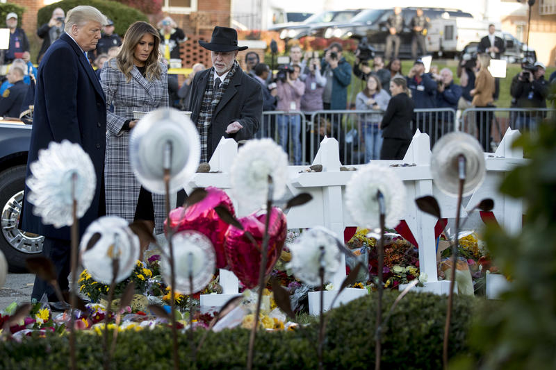 President Donald Trump and first lady Melania stop at a memorial outside of the Tree of Life Synagogue in Squirrel Hill on Tuesday, Oct. 30, 2018.