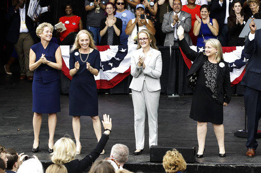 In this Sept. 21, 2018 photo, Pennsylvania congressional candidates, from left, Chrissy Houlahan, Mary Gay Scanlon, state Rep. Madeleine Dean and Susan Wild, take part in a campaign rally in Philadelphia. Each of the Democratic candidates won Tuesday.