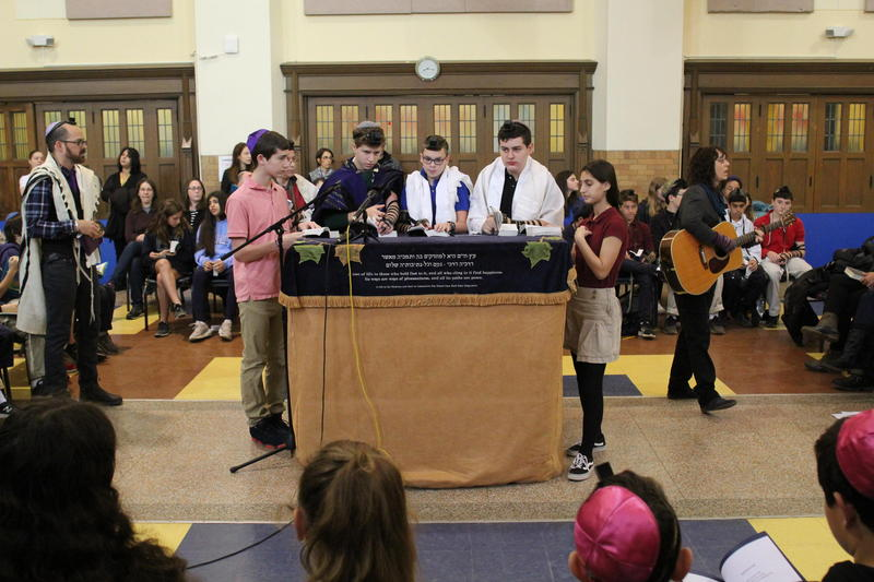 Students at the Community Day School in Squirrel Hill lead the school in a daily prayer service the week after the Tree of Life shooting.