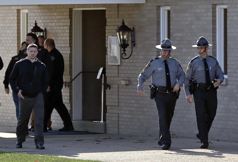 Police officers leave a visitation for New Kensington Police Officer Brian Shaw at a funeral home on Monday, Nov. 20, 2017, in Lower Burrell. Shaw was shot and killed during a traffic stop on Friday.