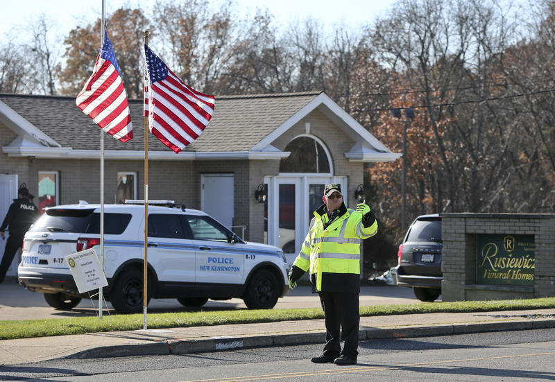 An officer directs traffic in front of the funeral home holding a visitation for New Kensington Police Officer Brian Shaw on Monday, Nov. 20, 2017, in Lower Burrell. Shaw was shot and killed during a traffic stop on Friday.