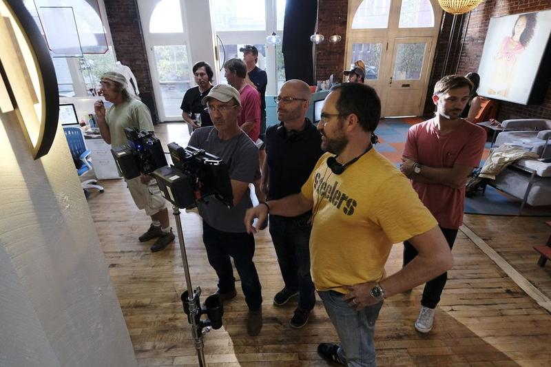 Executive producer John Hoberg (right) wears a Steelers tee beside director and co-creator Micheal Killen (center) during an extended shoot in Pittsburgh during the fall of 2016.