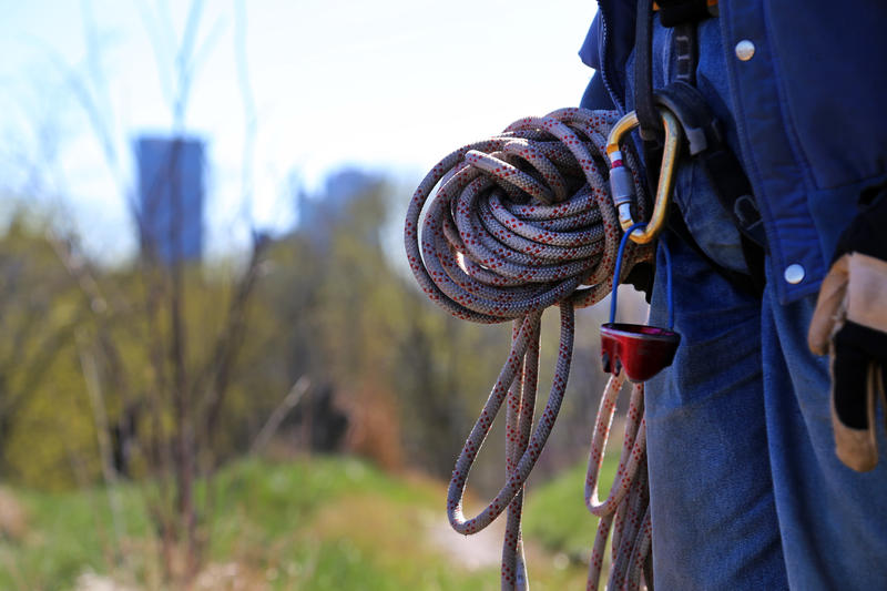 Veteran climber Bob Dodson, 70, of Churchill wears a static 10mm rope, harness, carabiner and belay device during a trash pick-up on the western hillside of Grandview Avenue on Saturday, April 8, 2017.