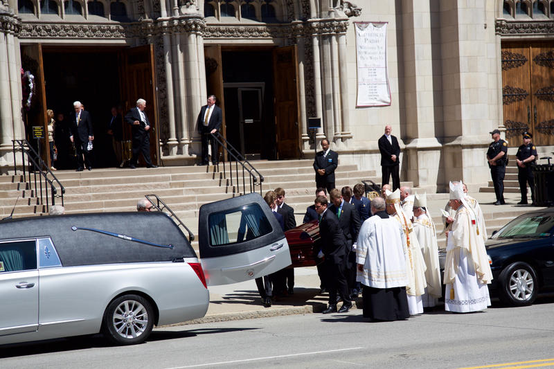 Pallbearers load the casket carrying Dan Rooney into a hearse as officiants look on St. Paul's Cathedral in Oakland, Tuesday, April 18, 2017.